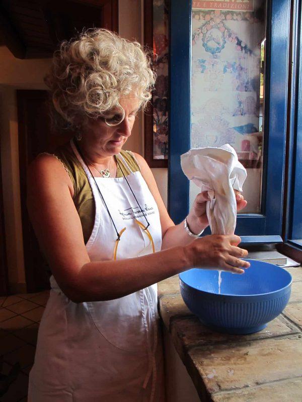 Classic squeeze method to make almond milk, Sicily