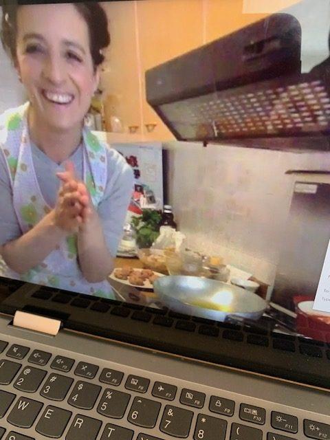 Gina teaching a cooking class