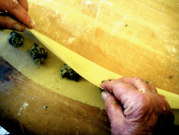 my mother's hands making agnolotti