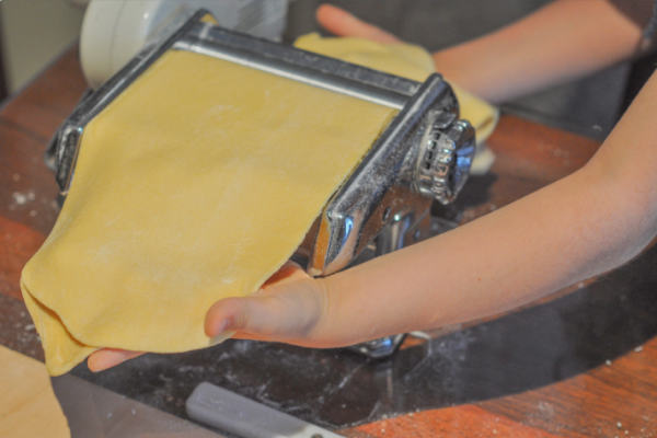 rolling out fresh pasta
